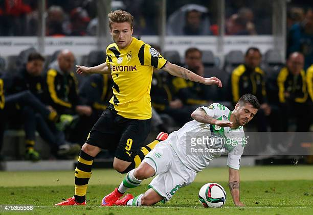 Ciro Immobile of Dortmund challenges Vieirinha of Wolfsburg during the DFB Cup Final match between Borussia Dortmund and VfL Wolfsburg at...