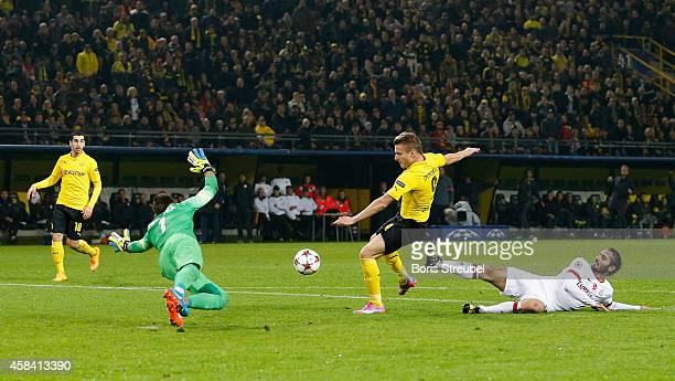 Ciro Immobile of Dortmund scores his team's third goal during the UEFA Champions League Group D match between Borussia Dortmund and Galatasaray AS at...