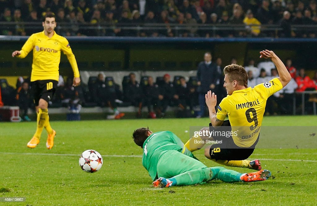 <a gi-track='captionPersonalityLinkClicked' href=/galleries/search?phrase=Ciro+Immobile&family=editorial&specificpeople=5820229 ng-click='$event.stopPropagation()'>Ciro Immobile</a> (R) of Dortmund scores his team's third goal during the UEFA Champions League Group D match between Borussia Dortmund and Galatasaray AS at Signal Iduna Park on November 4, 2014 in Dortmund, Germany.
