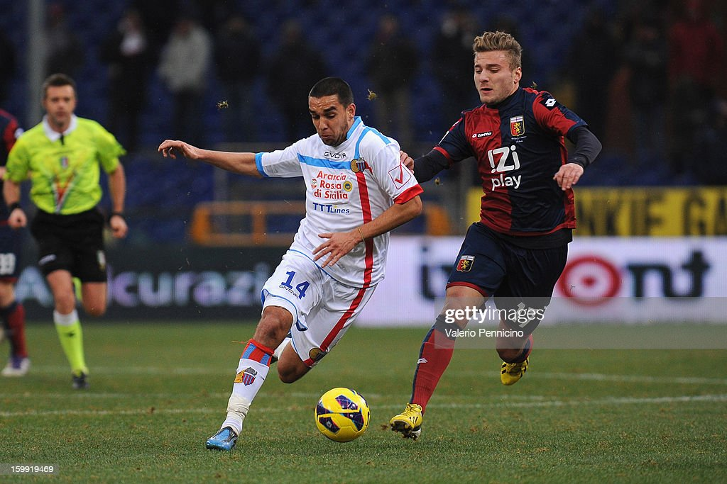 Ciro Immobile (R) of Genoa CFC competes with Giuseppe Bellusci of Calcio Catania during the Serie A match between Genoa CFC and Calcio Catania at Stadio Luigi Ferraris on January 20, 2013 in Genoa, Italy.