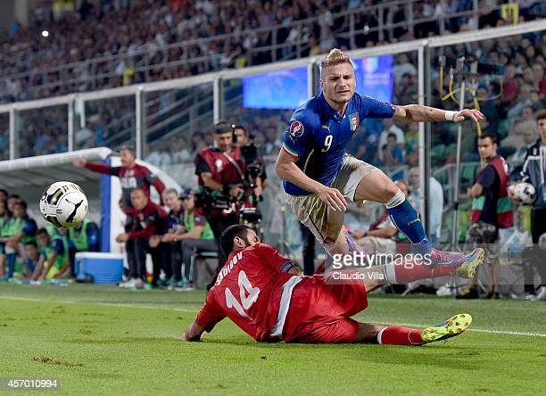 Ciro Immobile of Italy and Rashad Sadygov of Azerbaijan compete for the ball during the EURO 2016 Group H Qualifier match between Italy and...