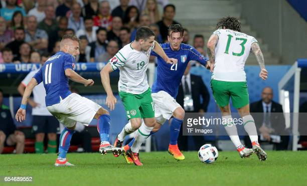 Ciro Immobile of Italy and Robbie Brady of Ireland and Federico Bernardeschi of Italy and Jeff Hendrick of Ireland battle for the ball during the...
