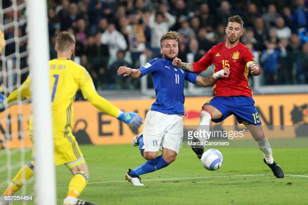 Ciro Immobile of Italy and Sergio Ramos of Spain compete for the ball during the WC 2018 football qualification match between Italy and Spain The...