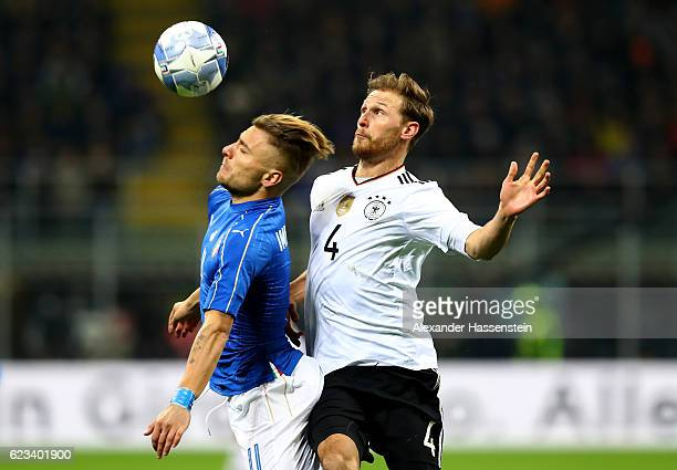 Ciro Immobile of Italy and Shkodran Mustafi of Germany battle for the ball during the International Friendly Match between Italy and Germany at...