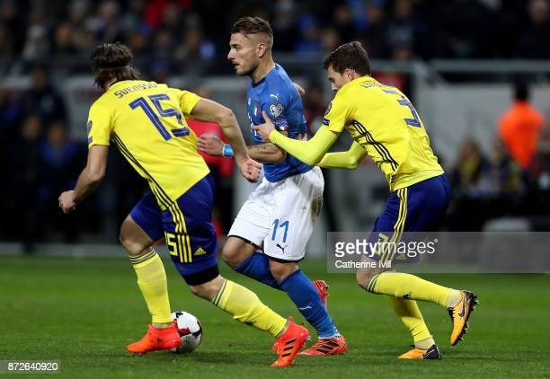 Ciro Immobile of Italy battles for possession with Gustav Svensson of Sweden and Victor Nilsson Lindelöf of Sweden during the FIFA 2018 World Cup...