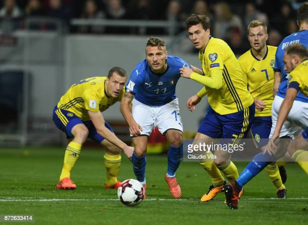 Ciro Immobile of Italy competes for the ball with Victor Nilsson Lindelof of Sweden during the FIFA 2018 World Cup Qualifier PlayOff First Leg...