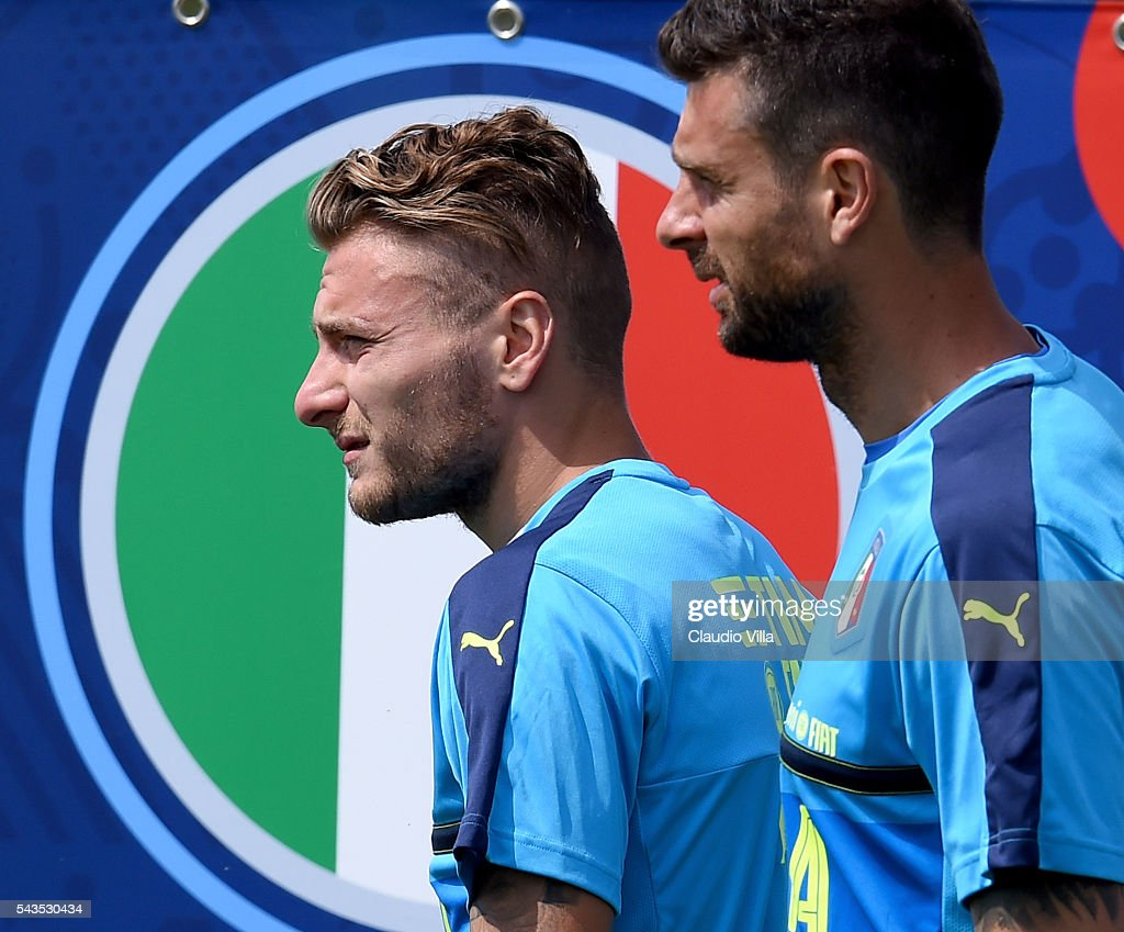 Ciro Immobile of Italy (L) looks on prior to the training session at 'Bernard Gasset' Training Center on June 29, 2016 in Montpellier, France.