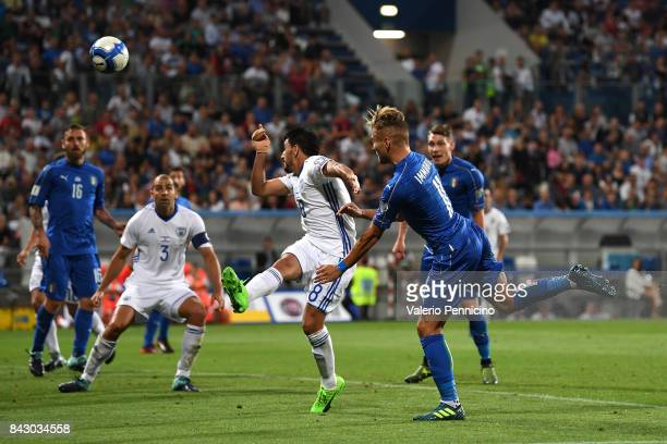 Ciro Immobile of Italy scores the opening goal during the FIFA 2018 World Cup Qualifier between Italy and Israel at Mapei Stadium Citta' del...