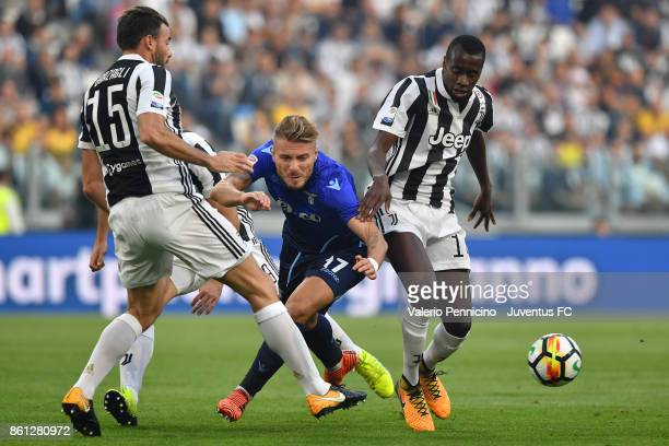 Ciro Immobile of Lazio and Blaise Matuidi of Juventus compete for the ball during the Serie A match between Juventus and SS Lazio on October 14 2017...
