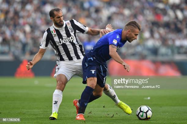 Ciro Immobile of Lazio and Giorgio Chiellini of Juventus compete for the ball during the Serie A match between Juventus and SS Lazio on October 14...