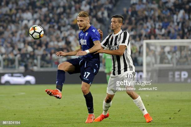 Ciro Immobile of Lazio and Rodrigo Bentancur of Juventus competes for the ball during the Serie A match between Juventus and SS Lazio on October 14...