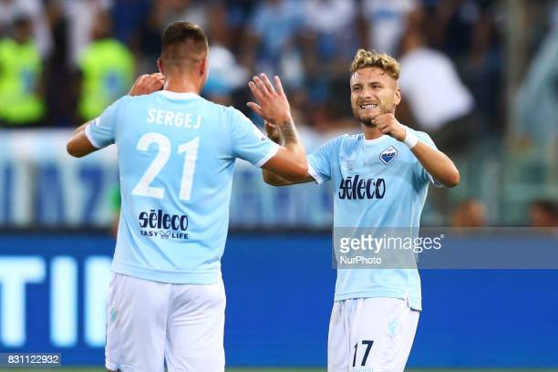 Ciro Immobile of Lazio and Sergej MilinkovicSavic of Lazio celebrating after the penalty of 01 scored during the Italian Supercup match between...