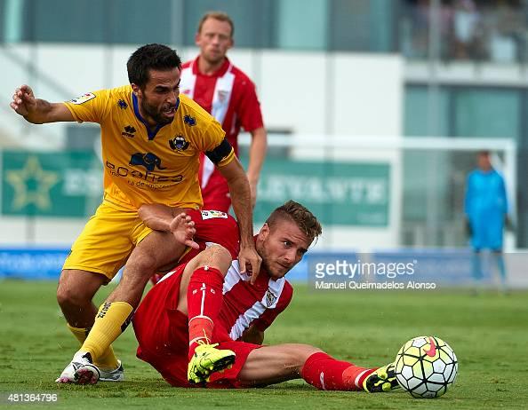 Ciro Immobile of Sevilla battles for the ball with Ruben Sanz of Alcorcon during a Pre Season Friendly match between Sevilla and Alcorcon at Pinatar...