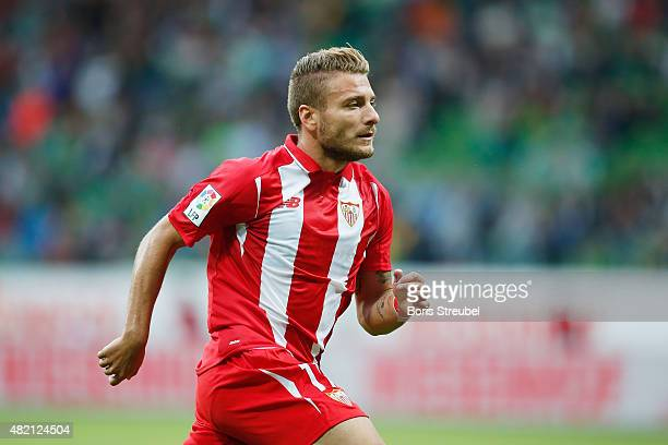 Ciro Immobile of Sevilla runs during the friendly match between SV Werder Bremen and FC Sevilla at Weserstadion on July 25 2015 in Bremen Germany