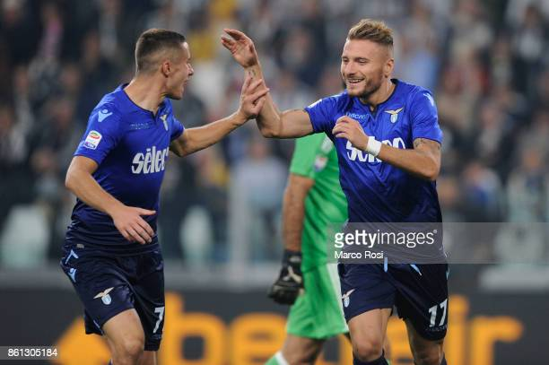 Ciro Immobile of SS Lazio celebrates a frist goal with his team mates during the Serie A match between Juventus and SS Lazio on October 14 2017 in...
