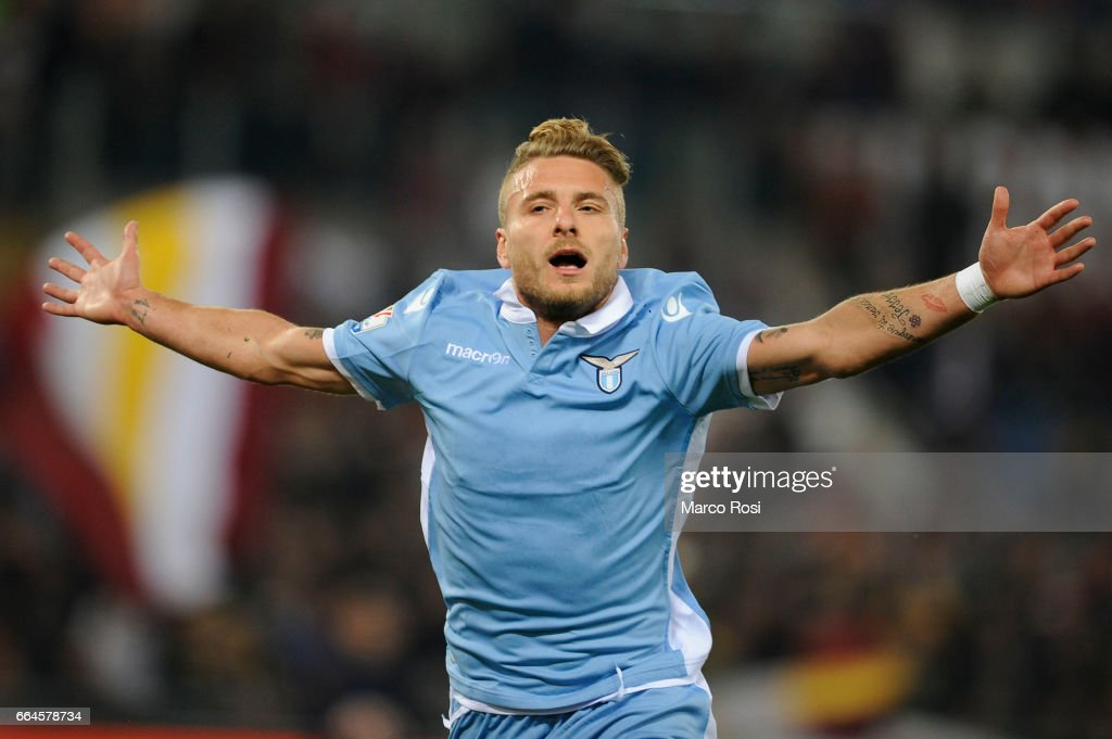 Ciro Immobile of SS lazio celebrates a second goal during the TIM Cup match between AS Roma and SS Lazio at Stadio Olimpico on April 4, 2017 in Rome, Italy.