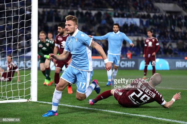 Ciro Immobile of SS Lazio celebrates scoring the opening goal during the Serie A match between SS Lazio and FC Torino at Stadio Olimpico on March 13...