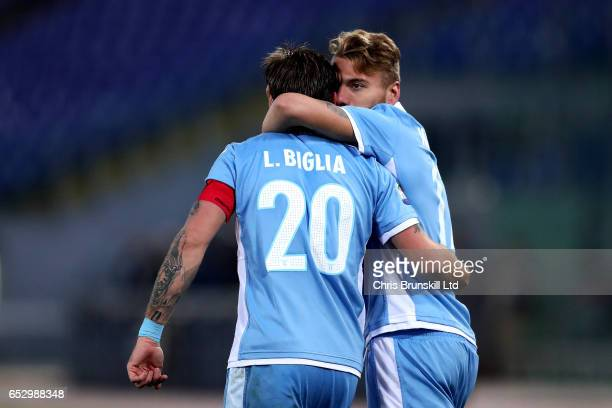Ciro Immobile of SS Lazio celebrates scoring the opening goal with teammate Lucas Biglia during the Serie A match between SS Lazio and FC Torino at...