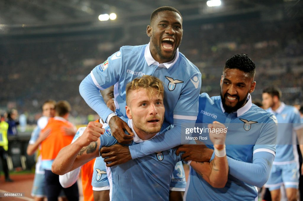 Ciro Immobile of SS Lazio celebrates their second goal with his team mate during the TIM Cup match between AS Roma and SS Lazio at Stadio Olimpico on April 4, 2017 in Rome, Italy.