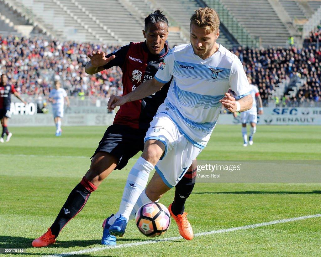 Ciro Immobile of SS Lazio compete for the ball with Bruno Alves of Cagliari Calcio during the Serie A match between Cagliari Calcio and SS Lazio at Stadio Sant'Elia on March 19, 2017 in Cagliari, Italy.
