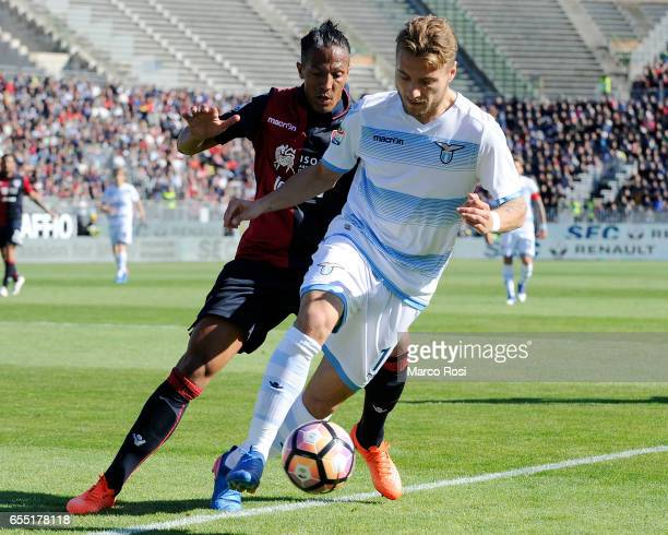 Ciro Immobile of SS Lazio compete for the ball with Bruno Alves of Cagliari Calcio during the Serie A match between Cagliari Calcio and SS Lazio at...