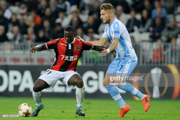 Ciro Immobile of SS Lazio compete for the ball with Mendy of OGC Nice during the UEFA Europa League group K match between OGC Nice and Lazio at...