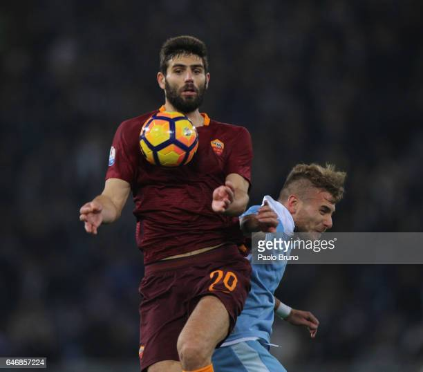 Ciro Immobile of SS Lazio competes for the ball with Federico Fazio of AS Roma during the TIM Cup match between SS Lazio and AS Roma at Olimpico...