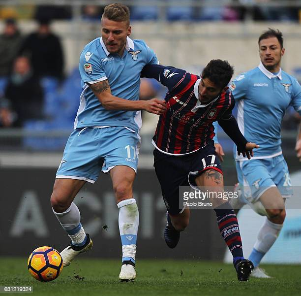 Ciro Immobile of SS Lazio competes for the ball with Federico Ceccherini of FC Crotone during the Serie A match between SS Lazio and FC Crotone at...
