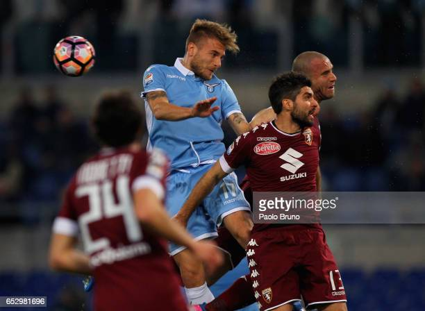 Ciro Immobile of SS Lazio competes for the ball with Marco Benassi of FC Torino during the Serie A match between SS Lazio and FC Torino at Stadio...