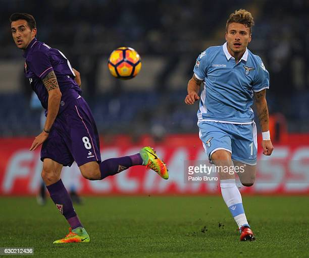 Ciro Immobile of SS Lazio competes for the ball with Matias Vecino of ACF Fiorentina during the Serie A match between SS Lazio and ACF Fiorentina at...