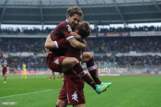 Ciro Immobile of Torino FC celebrates his goal with teammates Alessio Cerci during the Serie A match between Torino FC and AC Chievo Verona at Stadio...