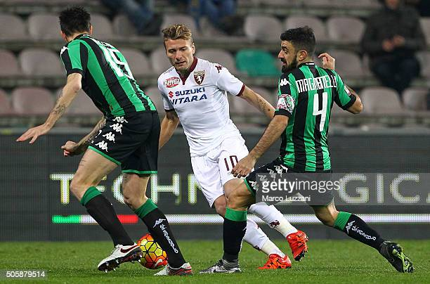 Ciro Immobile of Torino FC competes for the ball with Francesco Magnanelli and Francesco Acerbi of US Sassuolo Calcio during the Serie A match...