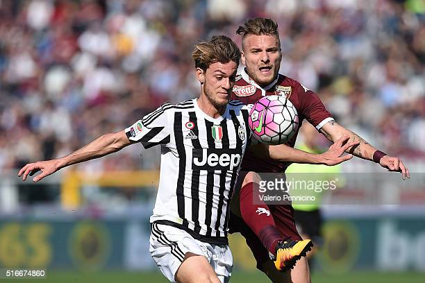 Ciro Immobile of Torino FC is challenged by Daniele Rugani of Juventus FC during the Serie A match between Torino FC and Juventus FC at Stadio...