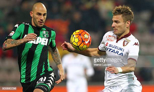 Ciro Immobile of Torino FC is challenged by Paolo Cannavaro of US Sassuolo Calcio during the Serie A match betweeen US Sassuolo Calcio and Torino FC...
