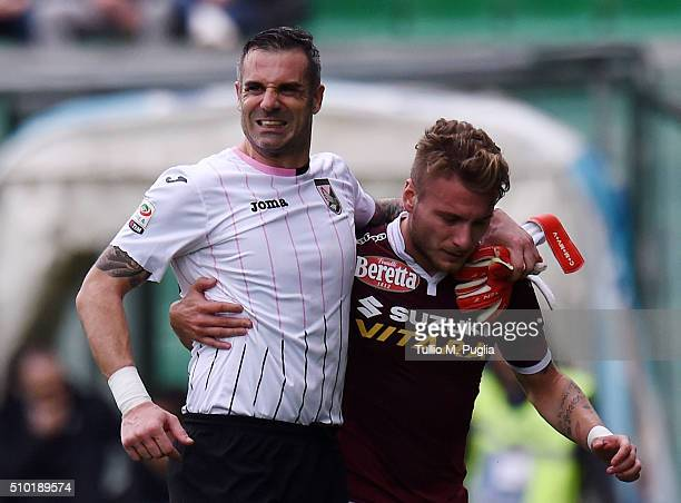 Ciro Immobile of Torino helps Stefano Sorrentino of Palermo after an injury during the Serie A match between US Citta di Palermo and Torino FC at...