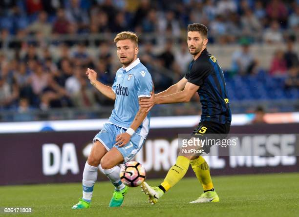 Ciro Immobile vies Roberto Gagliardini during the Italian Serie A football match between SS Lazio and FC Inter at the Olympic Stadium in Rome on may...