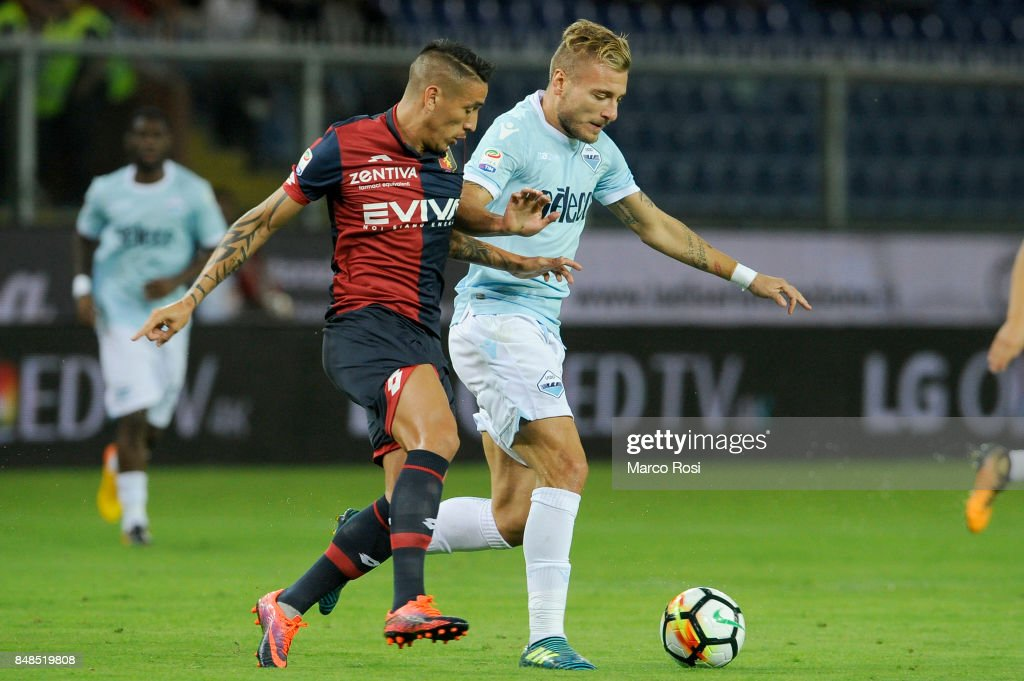 Ciro Immobili of SS Lazio compete for the ball with Adel Tarabat of Genoa CFC during the Serie A match between Genoa CFC and SS Lazio at Stadio Luigi Ferraris on September 17, 2017 in Genoa, Italy.