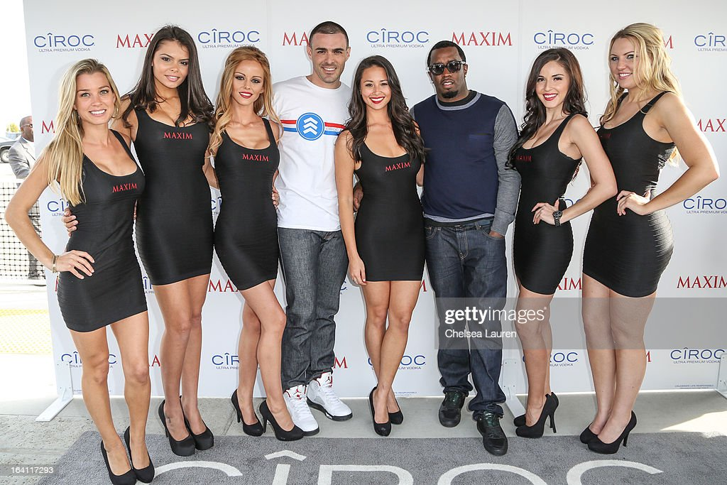 Ciroc Americano military ambassador Christopher Minaya (4L) and rapper/producer/actor <a gi-track='captionPersonalityLinkClicked' href=/galleries/search?phrase=Sean+Combs&family=editorial&specificpeople=178993 ng-click='$event.stopPropagation()'>Sean Combs</a> (3R) pose with Maxim models at Ciroc and Maxim celebration of the National Day of Honor at Miramar MCX Military Base on March 19, 2013 in San Diego, California.