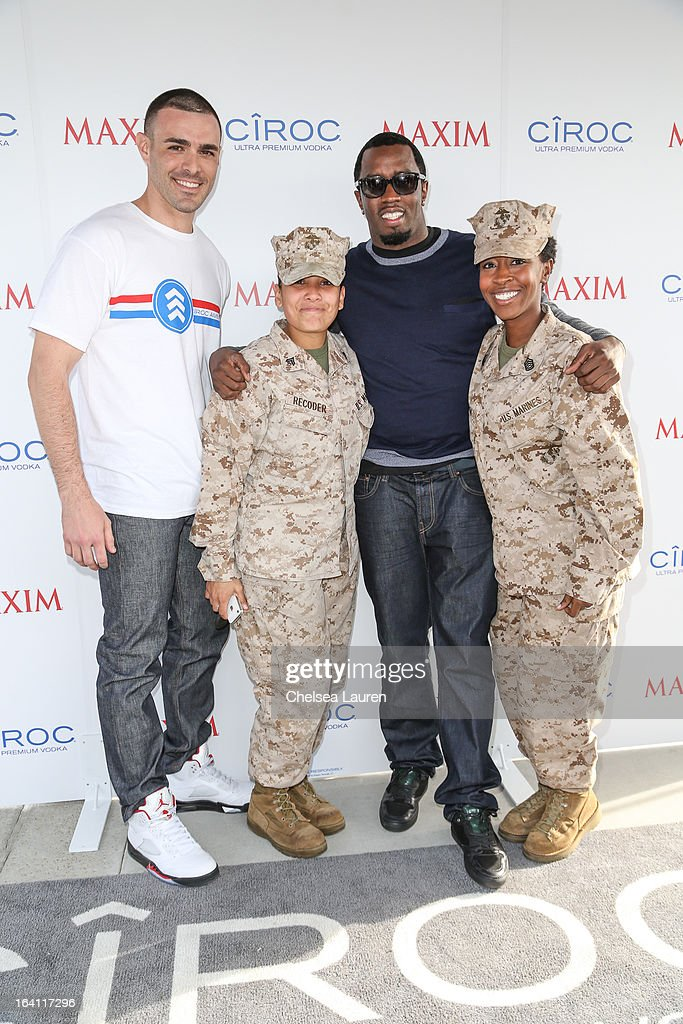 Ciroc Americano military ambassador Christopher Minaya (L) and rapper/producer/actor <a gi-track='captionPersonalityLinkClicked' href=/galleries/search?phrase=Sean+Combs&family=editorial&specificpeople=178993 ng-click='$event.stopPropagation()'>Sean Combs</a> (2nd R) attend Ciroc and Maxim celebration of the National Day of Honor at Miramar MCX Military Base on March 19, 2013 in San Diego, California.