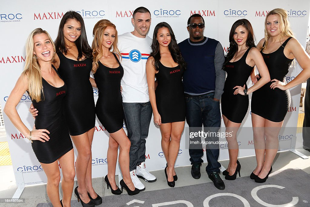 Ciroc Americano military ambassador Christopher Minaya and Producer/entrepreneur <a gi-track='captionPersonalityLinkClicked' href=/galleries/search?phrase=Sean+Combs&family=editorial&specificpeople=178993 ng-click='$event.stopPropagation()'>Sean Combs</a> pose with Maxim models during the Ciroc and Maxim celebration of the National Day of Honor at Marine Corps Air Station on March 19, 2013 in San Diego, California.