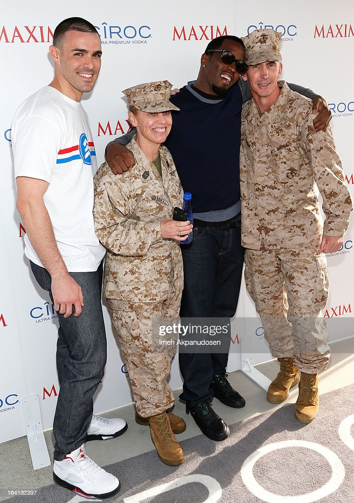 Ciroc Americano military ambassador Christopher Minaya (L) and Producer/entrepreneur <a gi-track='captionPersonalityLinkClicked' href=/galleries/search?phrase=Sean+Combs&family=editorial&specificpeople=178993 ng-click='$event.stopPropagation()'>Sean Combs</a> (2nd R) attend the Ciroc and Maxim celebration of the National Day of Honor at Marine Corps Air Station on March 19, 2013 in San Diego, California.