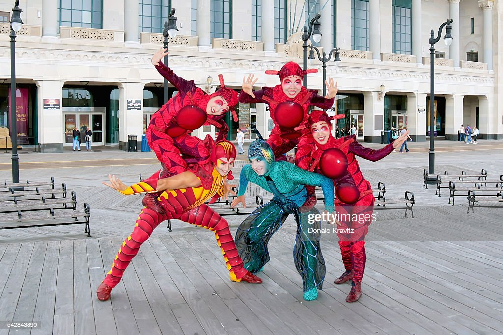 Cirque Du Soleil Costumed OVO performers do acrobatics in front of Atlantic City Boardwalk Hall on June 24, 2016 in Atlantic City, New Jersey.