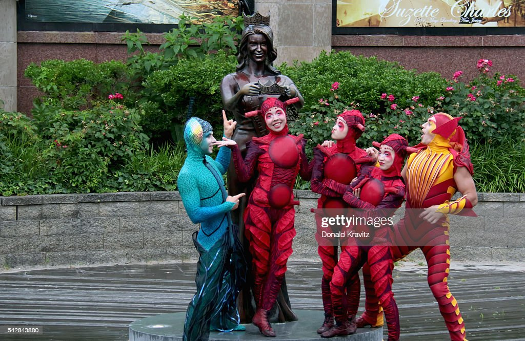 Cirque Du Soleil Costumed OVO performers pose in front of Miss America statue in front of Atlantic City Boardwalk Hall on June 24, 2016 in Atlantic City, New Jersey.