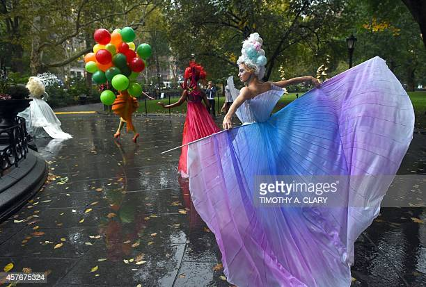 Cirque du Soleil members perform during an event titled 'The Scent of Inspiration' in Madison Square Park October 22 2014 to promote SC Johnson Son...