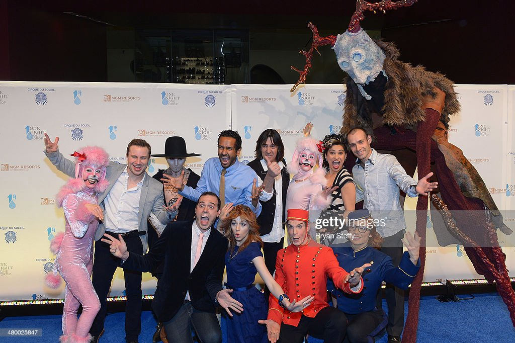 Cirque du Soleil performers and One Night for One Drop creator and director Mukhtar O.S. Mukhtar (BRCL) and artistic development director Loppo Martinez (BRCR) and violinist Lindsey Stirling FRC) arrive at Cirque du Soleil's 2nd annual 'One Night for One Drop' at Aureole Las Vegas at the Mandalay Bay Resort and Casino on March 21, 2014 in Las Vegas, Nevada.