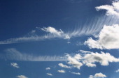 Cirrus and cumulus clouds are seen in the sky over Mauerstetten southern Germany on October 13 2013 AFP PHOTO / DPA / KARLJOSEF HILDENBRAND / GERMANY...