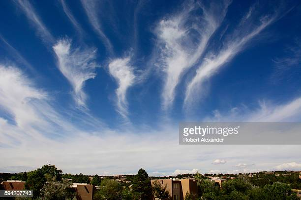 Cirrus clouds form an unusual pattern in the sky over Santa Fe New Mexico