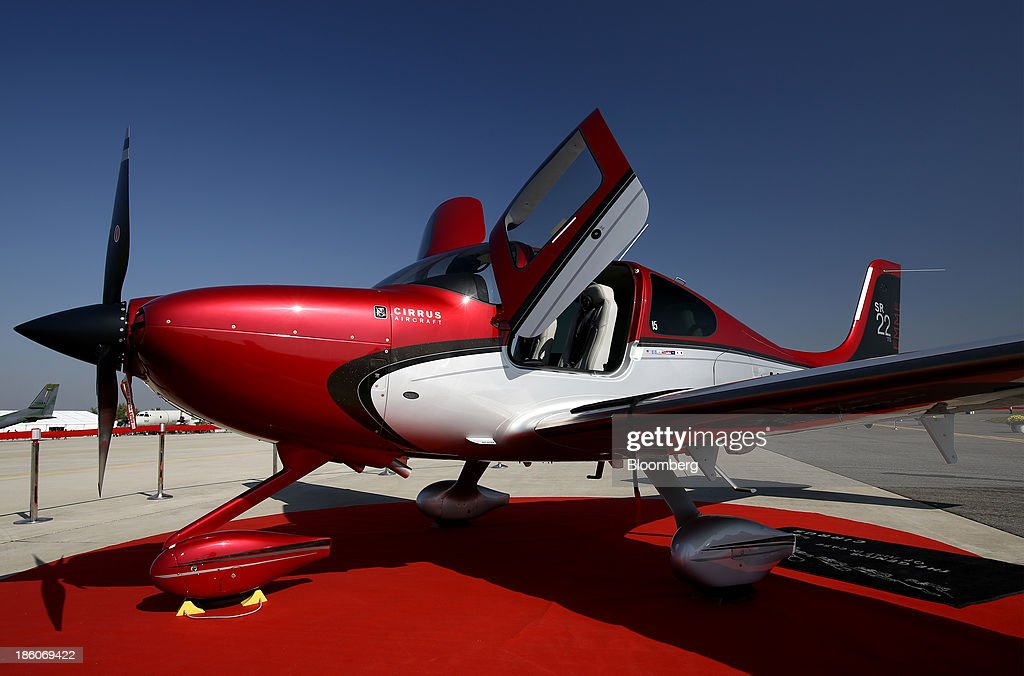 A Cirrus SR-22 aircraft stands on display during the Cheongju International Airport Air Show on the sidelines of the Seoul International Aerospace & Defense Exhibition 2013 at Cheongju International Airport in Cheongju, South Korea, on Friday, Oct. 25, 2013. The exhibition will run till Nov. 3. Photographer: SeongJoon Cho/Bloomberg via Getty Images