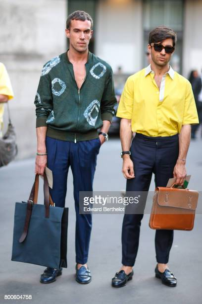 Cirulli Filippo wears a green jacket and blue pants Fiora Filippo wears a yellow shirt blue pants blue shoes and a brown bag outside the Hermes show...