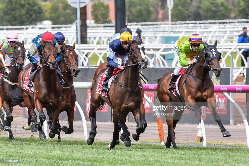 Cismontane (NZ) ridden by Beau Mertens leads the field on the first lap of the the Emirates Melbourne Cup at Flemington Racecourse on November 07, 2017 in Flemington, Australia.